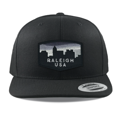 Yupoong-6089-black-snapback-flatbill-raleigh-skyline-embroidered-patch